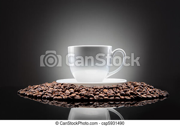 white cup with coffee beans on black - csp5931490