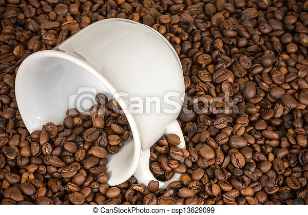 White cup with many coffee beans - csp13629099