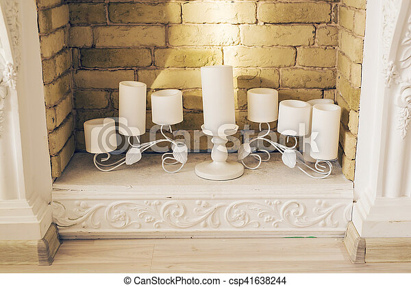 White Decorative Fireplace With Candles Fireplace With Beautiful Decorations In Comfortable Living Room Canstock