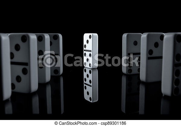 White dominoes in the dark close up - csp89301186