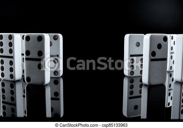 White dominoes in the dark close up - csp85133963