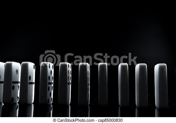 White dominoes in the dark close up - csp85000830