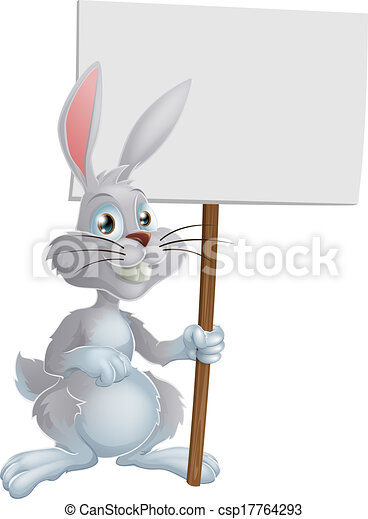 White Easter bunny holding sign - csp17764293