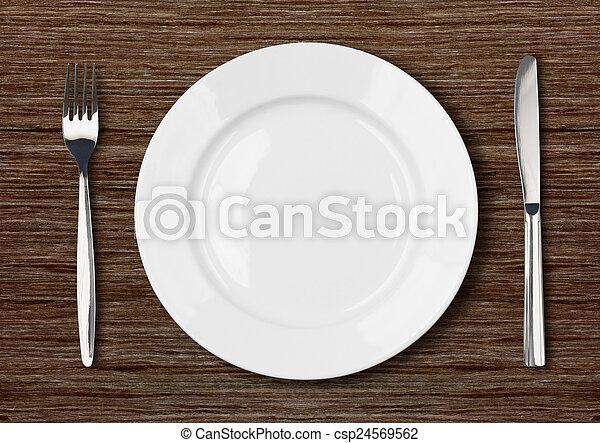 white empty dinner plate setting on dark wooden table - csp24569562 & White empty dinner plate setting on dark wooden table. White empty ...