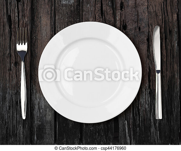 white empty dinner plate setting on old dark wooden table - csp44176960 & White empty dinner plate setting on old dark wooden table. White ...
