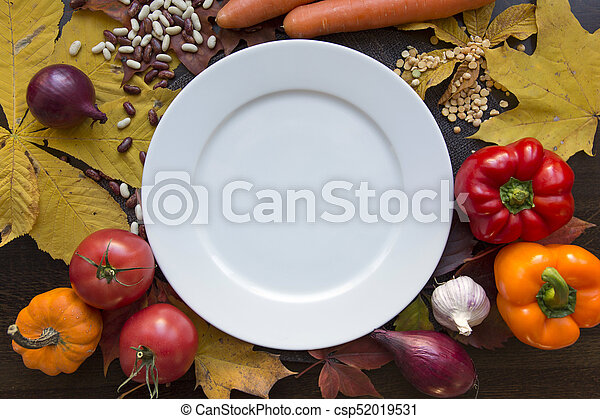 White empty plate with autumn harvest top view - csp52019531