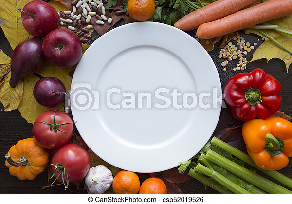 White empty plate with various vegetables top view - csp52019526