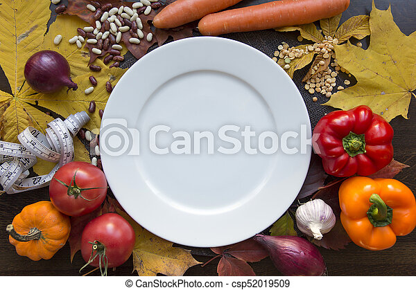 White emty plate with measuring tape and vegetables top view - csp52019509
