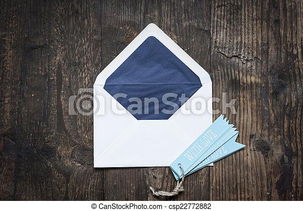 white envelope on wooden background - csp22772882
