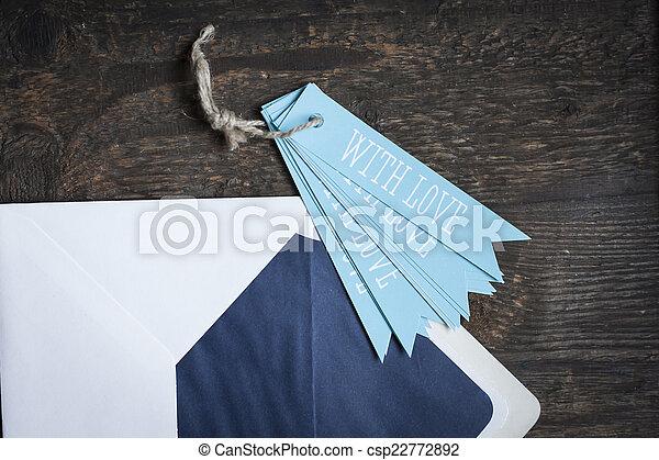 white envelope on wooden background - csp22772892
