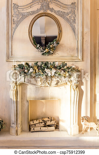 White Fireplace In Light Room With Christmas Decoration Decorative Fireplace With Christmas Fir Branches In Stylish Room Canstock