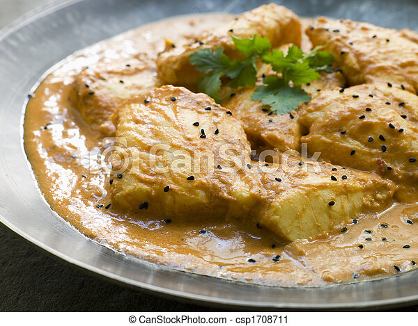 White Fish Molee on a Pewter Plate with Nigella Seeds - csp1708711