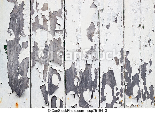 White flaky paint on a old weathered wooden fence. - csp7519413