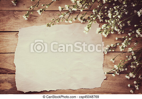 White Flower On Grunge Wood Board And Paper Background With Space