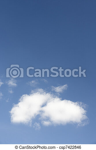White Fluffy Cloud Against Blue Sky - csp7422846