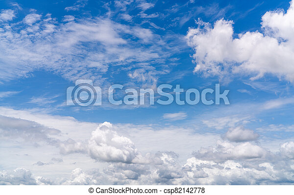 White fluffy clouds on blue sky. Soft touch feeling like cotton. White puffy clouds cape with space for text. Beauty in nature. Close-up white cumulus clouds texture background. Sky on sunny day. - csp82142778