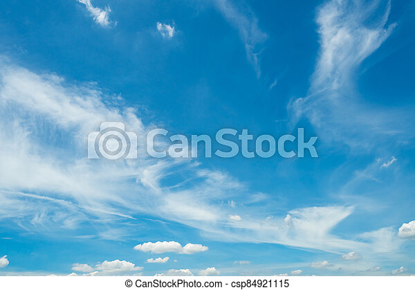 White fluffy clouds on blue sky. Soft touch feeling like cotton. White cloudscape with space for text. Beauty in nature. Close-up white cumulus clouds texture background. Sky on sunny day. - csp84921115