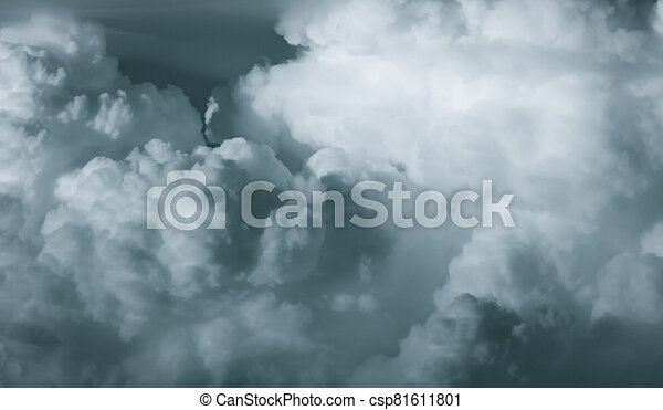 White fluffy clouds on dark sky. Soft touch feeling like cotton. Stormy sky before raining. Beauty in nature. The combination of rain clouds before rain. Close-up group of clouds texture background. - csp81611801