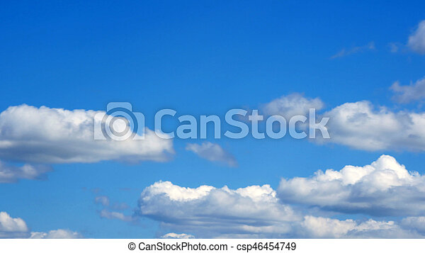white fluffy clouds over blue sky on sunny day - csp46454749