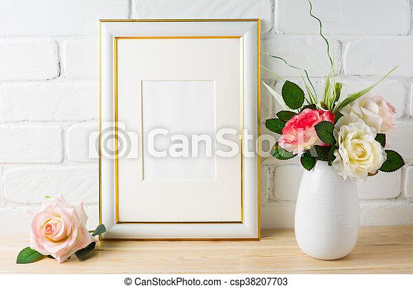 White frame mockup on brick wall with roses. vertical white frame ...