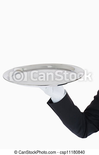 White gloved hand holding a silver tray - csp11180840