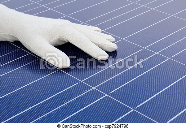 White gloved hand in front of solar cells - csp7924798