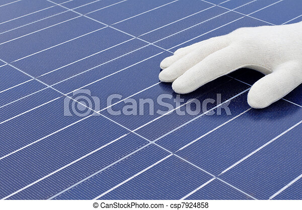 White gloved hand in front of solar cells - csp7924858