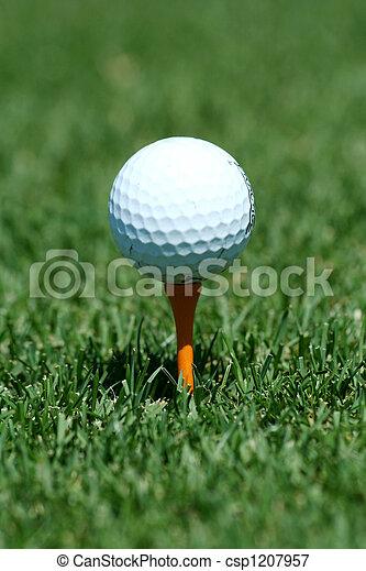 White golf ball on a orange tee - csp1207957