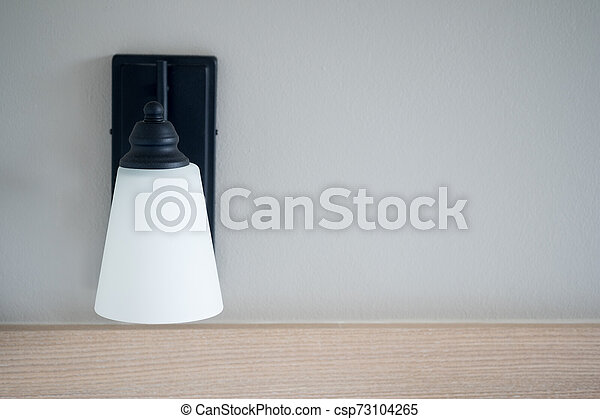 White lamp against the gray wall - csp73104265
