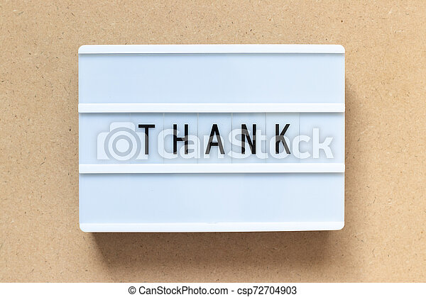 White lightbox with word thank on wood background - csp72704903