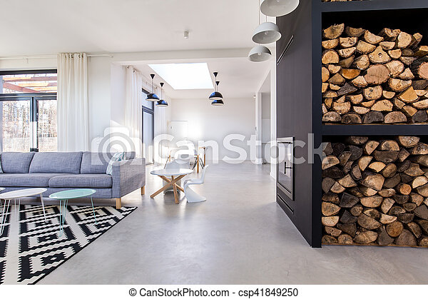 White living room in modern minimalist house with concrete floor - csp41849250