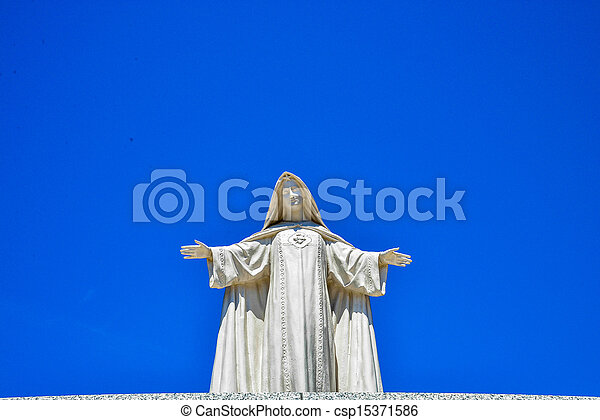 White Maria statue with blue sky1 - csp15371586