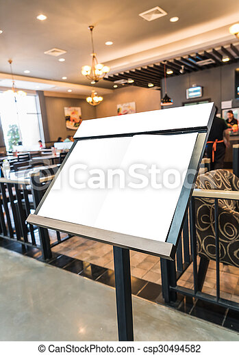 White menu board in front of the restaurant. - csp30494582
