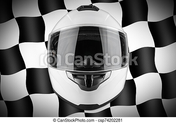 White motorcycle carbon integral crash helmet front of motorsport black and chequered flag background. car kart racing transportation safety concept - csp74202281