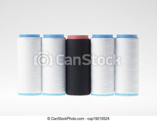 White on white, spools of thread on white background - csp19216524