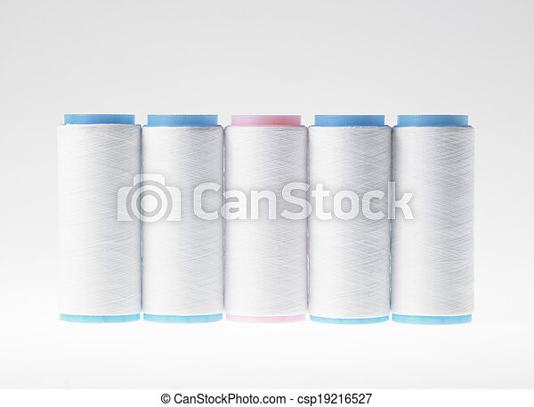 White on white, spools of thread on white background - csp19216527