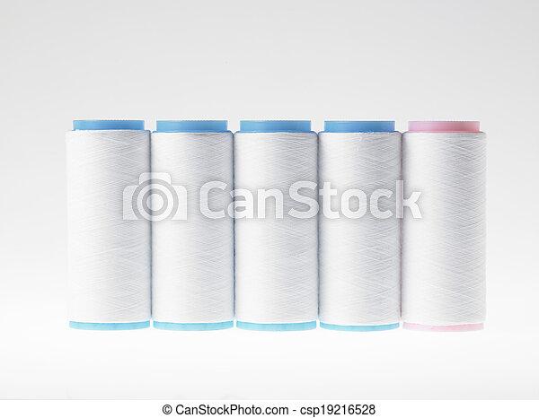 White on white, spools of thread on white background - csp19216528