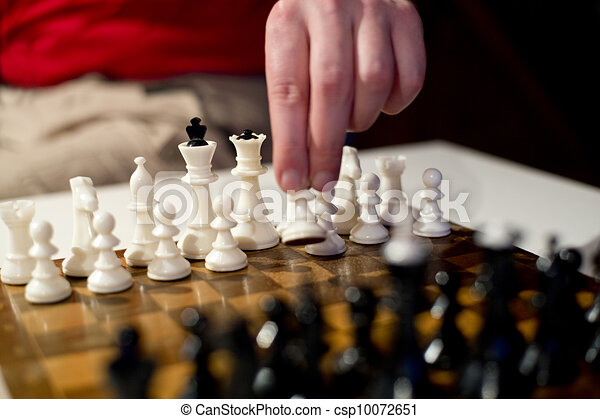 White pawn in player hand - csp10072651