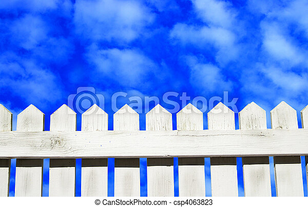 White picket fence and blue sky - csp4063823