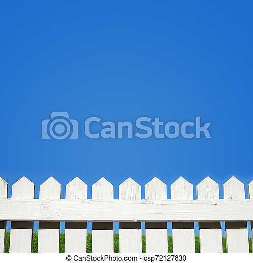 White picket fence and blue sky - csp72127830