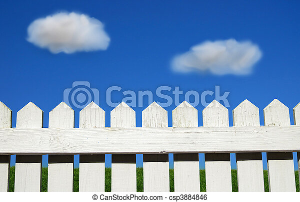 White picket fence, green grass and sky - csp3884846