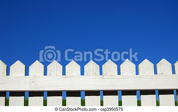 White picket fence, green grass and sky - csp3950575