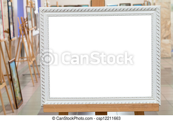 white picture frame on easel in art gallery hall - csp12211663