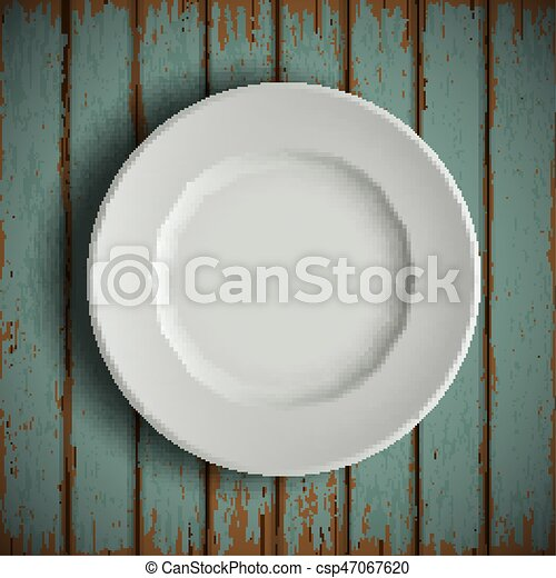 white plate on old wooden table - csp47067620