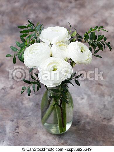 White ranunculus flowers in vase grey background white ranunculus white ranunculus flowers in vase grey background csp36925649 mightylinksfo