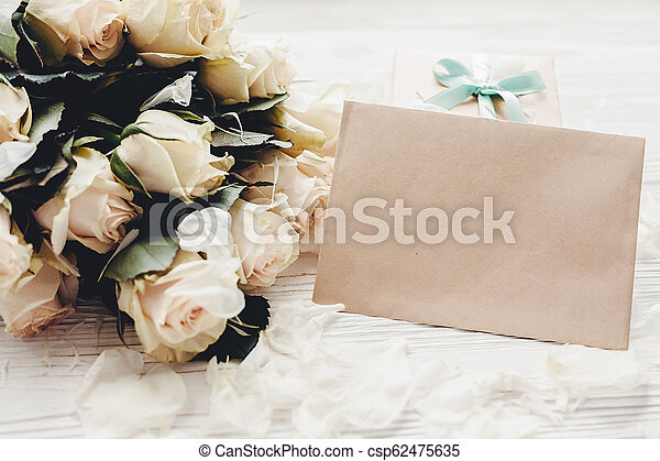 White Roses With Empty Card And Gift Box On Wooden Background