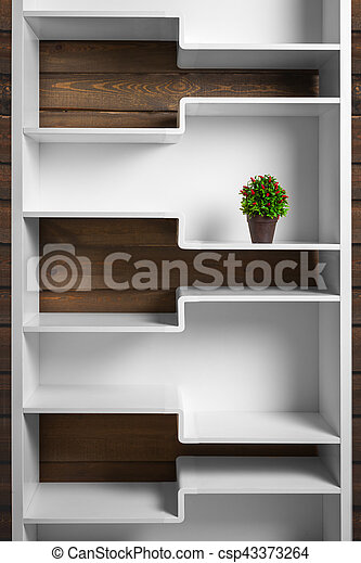 white shelf and green plant in pot - csp43373264