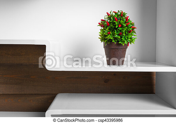 white shelves and green plant in pot - csp43395986