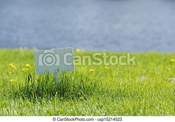 White signboard on grass - csp15214523