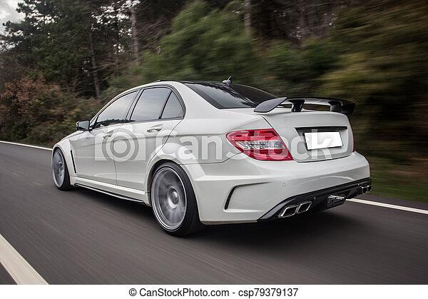 White sport sedan on the road - csp79379137